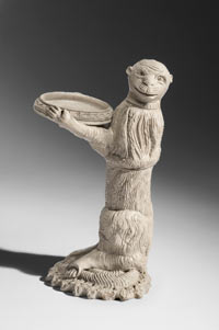 Image 01: Monkey Holding a Dish, probably a Sand Holder from a Writing Set