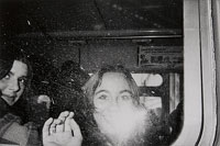 Untitled (girls' faces flashed in bus window)