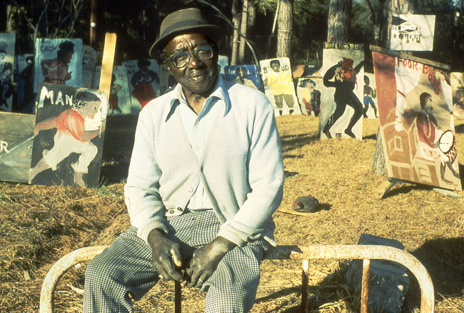 Sam Doyle in his yard, c. 1983