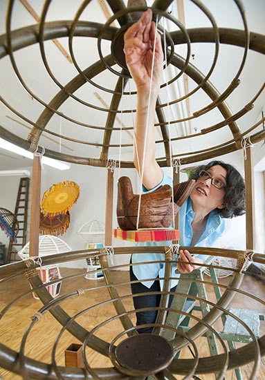 Spector works on one of her sculptures, <i>It All</i>, in her studio near Fabric Row in Philadelphia.