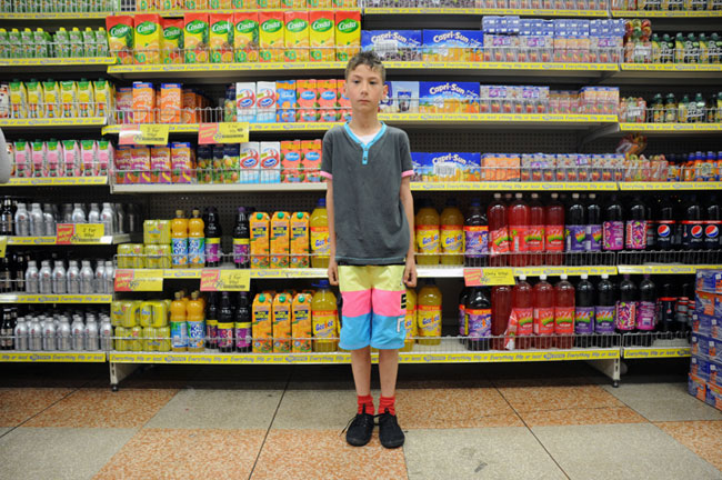 Boy at Brighton Pound Store, Brighton, England